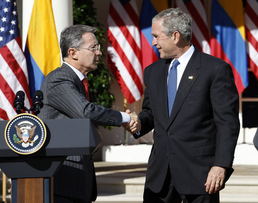 President George W. Bush shakes hands with Colombian President Alvaro Uribe following a joint press availability Saturday, Sept. 20, 2008, in the Rose Garden at the White House. White House photo by Eric Draper