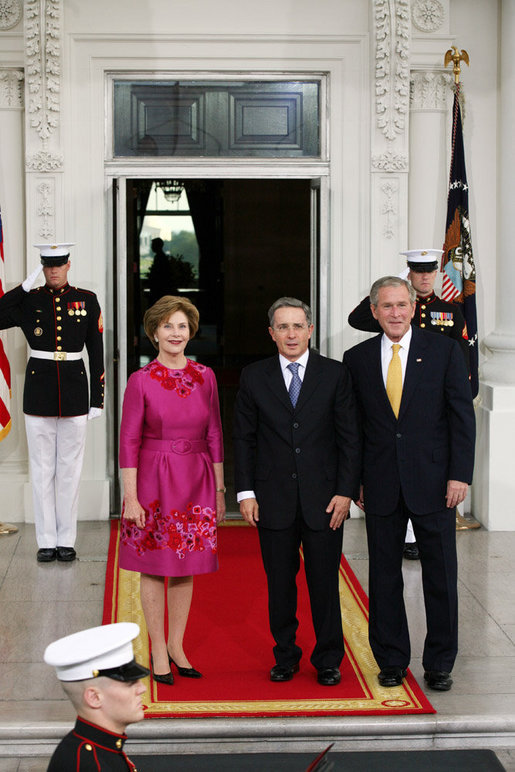 President George W. Bush and Mrs. Laura Bush greet Colombian President Alvaro Uribe on the North Portico Saturday, Sept. 20, 2008, for a social dinner at the White House. White House photo by Joyce N. Boghosian