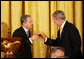 President George W. Bush shares a toast with Colombian President Alvaro Uribe Saturday, Sept. 20, 2008, during a social dinner with the President of Colombia at the White House. White House photo by Joyce N. Boghosian