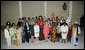 Mrs. Laura Bush, center in salmon-colored suit, hosts 36 other first ladies from around the world at the White House Symposium on Advancing Global Literacy at the Metropolitan Museum of Art in New York City, Sept. 22, 2008. The first ladies were in New York City while their spouses attend the United Nations General Assembly. White House photo by Chris Greenberg