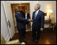 "President George W. Bush greets Uganda's President Yoweri Museveni Tuesday, Sept. 23, 2008, at The Waldorf-Astoria Hotel in New York. President Bush thanked his counterpart for implementing the Malaria Initiative and said, ""There's been over 200,000 bed nets distributed in your country, Mr. President, and that's because of the leadership of you and the organization of your government."" White House photo by Eric Draper"