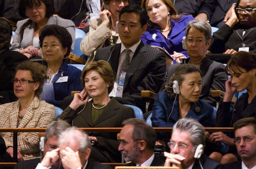 Mrs. Laura Bush listens from the audience as President George W. Bush delivers his address Tuesday, Sept. 23, 2008, to the United Nations General Assembly in at the U.N. Headquarters in New York City. Sitting with her from left are: Dr. Cheryl Benard, spouse of U.S. Ambassador to the United Nations Zalmay Khalilzad; Mrs. Yoo Soon-taek, spouse of U.N. Secretary-General Ban Ki-moon, and Mrs. Carla Bruni Sarkozy, spouse of French President Nicolas Sarkozy. White House photo by Chris Greenberg