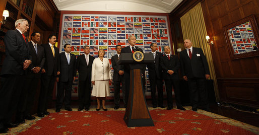 "President George W. Bush is surrounded by leaders from the Western Hemisphere as he delivers a statement on free trade Wednesday, Sept. 24, 2008, at the Council of the Americas in New York City. Said the President, ""Each of the 11 countries here has a free trade agreement with the United States, or one pending before Congress. Free and fair trade is in our mutual interests."" White House photo by Eric Draper"