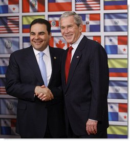 "President George W. Bush shakes hands with President Antonio Saca of El Salvador after delivering a statement on temporary protected status during a visit by President Bush Wednesday, Sept. 24, 2008, to the Council of the Americas. Said President Bush, ""I want to let my friend know, and the people of El Salvador, that the United States will extend TPS status to El Salvadoreans living in our country. I'm proud to make this announcement with you standing by my side.""  White House photo by Eric Draper"