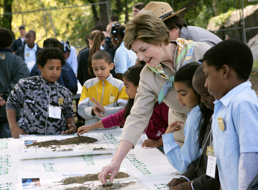 Mrs. Laura Bush and children from the Adam Clayton Powell Jr. Elementary School (P.S. 153) and the Boys and Girls Club of Harlem do a 'soil sampling' as part of the First Bloom program at the Hamilton Grange National Memorial in New York City, Sept. 24, 2008. The activity helps children learn about the characteristics of local soil and thus the kinds of plants best suited to the area. The park is the historic home of Alexander Hamilton. White House photo by Chris Greenberg