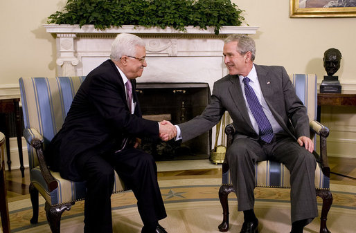 "President George W. Bush and President Mahmoud Abbas exchange handshakes Thursday, Sept. 25, 2008, during their visit in the Oval Office of the White House. The leader of the Palestinian Authority thanked President Bush for his efforts to bring peace to the Mideast saying, ""Mr. President, I would like to take the opportunity to thank you and thank the United States for the help and the support and the aid that you have given us, and as well as the efforts that you led to mobilize the world to help the Palestinian Authority on the economic front as well as on the security front. Mr. President, we will continue to work with you and we will continue to keep the hope alive in order to reach a political solution for our issue and for the Middle East."" White House photo by Eric Draper"