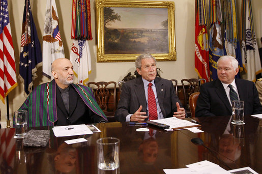 President George W. Bush is joined by President Hamid Karzai of Afghanistan during a video teleconference with U.S. Provincial Reconstruction team leaders, National Guard Agriculture Development team representatives and Afghan governors Friday, Sept. 26, 2008, in the Roosevelt Room at the White House. U.S. Secretary of Defense Robert Gates is seen at right. White House photo by Eric Draper