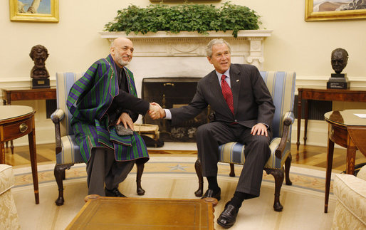 President George W. Bush meets with President Hamid Karzai of Afghanistan in the Oval Office Friday, Sept. 26, 2008, at the White House. White House photo by Eric Draper