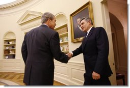 President George W. Bush welcomes Prime Minister Gordon Brown of the United Kingdom to the Oval Office Friday, Sept. 26, 2008, at the White House.  White House photo by Eric Draper