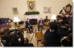 President George W. Bush is joined by Prime Minister Gordon Brown of the United Kingdom during a statement to reporters about their meeting in the Oval Office Friday, Sept. 26, 2008, at the White House. White House photo by Eric Draper