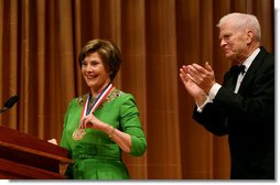 Mrs. Laura Bush is honored with the Living Legend Medallion by Dr. James Billington, the Librarian of Congress, Friday evening, Sept. 26, 2008 in Washington, D.C., during the 2008 National Book Festival Gala Performance.  White House photo by Joyce N. Boghosian
