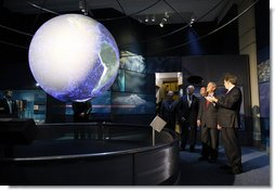 President George W. Bush views a display in the new Sant Ocean Hall as he is escorted by Christian Samper, Director of the Smithsonian Museum of Natural History, right, Friday, Sept. 26, 2008, during his visit to the Smithsonian Museum of Natural History in Washington, D.C. White House photo by Eric Draper