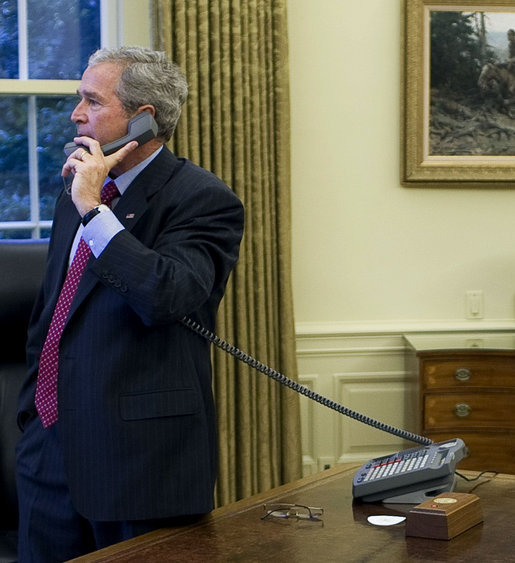 President George W. Bush places phone calls to Congressional members Friday, Sept. 26, 2008, from the Oval Office of the White House as negotiations continued on the financial rescue package. White House photo by Eric Draper