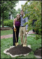 Jenna Hager, daughter of President George W. Bush and Mrs. Laura Bush, and husband Henry Hager pose for a photo after shoveling dirt onto a Cherokee Princess Dogwood during a commemorative tree planting ceremony Saturday, Sept. 27, 2008, on the South Lawn of the White House. White House photo by Joyce N. Boghosian