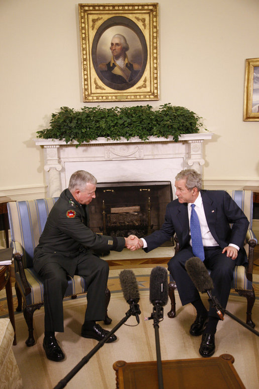 President George W. Bush welcomes General David D. McKiernan, Commander for NATO International Security Assistance Force in Afghanistan, to the Oval Office Wednesday, Oct. 1, 2008. White House photo by Eric Draper