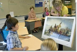 Mrs. Laura Bush watches during a visit to the fourth-grade classroom of Susan Weekes at the Riverside Elementary School in Bismarck, N.D., Thursday, Oct. 2, 2008, as Ms. Weekes shows students a painting by Emanuel Leutze of General George Washington crossing the Delaware River. The First Lady was visiting the school to highlight the National Endowment for the Humanities ' Picturing America' program which provides iconic artwork and photography for students to study. White House photo by Chris Greenberg