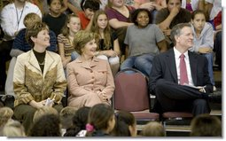 Mrs. Laura Bush enjoys a school assembly program, with Ms. Wilda Lu Nelson, Principal of the Riverside Elementary School, left, and Dr. Thomas Lindsay, Deputy Chairman of the National Endowment for the Humanities, during a visit to the school in Bismarck, N.D., Thursday, Oct. 2, 2008. White House photo by Chris Greenberg