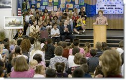 Mrs. Laura Bush addresses the Riverside Elementary School assembly in Bismarck, N.D., Thursday, Oct. 2, 2008, about the National Endowment for the Humanities' Picturing America' program. The program uses iconic artwork - such as the Washington Crossing the Delaware painting displayed nearby - and photography to teach children about architecture, art, and history as they discuss the images. White House photo by Chris Greenberg