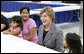 Mrs. Laura Bush visits with evacuee Deseray Ortiz and her daughters, Delilah, 3, left and Mariah, 8, right, Friday, Oct. 3, 2008, at the Auchan Red Cross Shelter in Houston for those individiuals and families who still need assistance as a result of Hurricane Ike. White House photo by Chris Greenberg