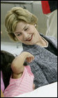 Mrs. Laura Bush shares a moment with Delilah Winters, 3, during a visit Friday, Oct. 3, 2008, to the Auchan Red Cross Shelter in Houston for those individiuals and families who still need assistance as a result of Hurricane Ike. White House photo by Chris Greenberg