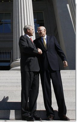 "President George W. Bush shakes hands with Secretary Hank Paulson of the U.S. Department of Treasury after visiting the department Friday, Oct. 3, 2008. Said the President upon his departure, ""Mr. Secretary, you and your team have worked incredibly hard. You've worked with the Congress; you've worked with the financial markets, both domestically and internationally. I know that your people are exhausted in there, and I really appreciate the fact that I'll be signing a piece of legislation that will be a part of solving this crisis, an important part of solving the crisis."" White House photo by Eric Draper"