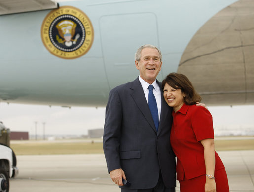 President George W. Bush hugs Freedom Corps greeter Sonya McDonald upon his arrival Monday, Oct. 6, 2008, in San Antonio, Texas. In January 2006, while her husband was deployed to Iraq, Mrs. McDonald spearheaded a fundraising effort to benefit Fisher House. Her goal was to raise $200,000 between Memorial Day and Independence Day 2006. She developed and implemented a marketing plan and solicited help from local businesses and organizations to generate donations. White House photo by Eric Draper