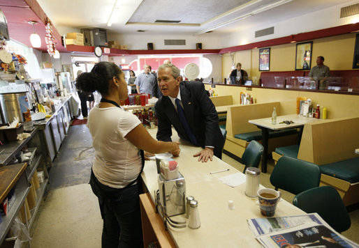 President George W. Bush greets an employee inside Olmos Pharmacy in San Antonio, Texas Monday, Oct. 6, 2008, where he greeted local citizens and met with business owners about the current economic climate. The Pharmacy was established in 1938 and while it no longer operates as a pharmacy, it has retained its original soda fountain and lunch counter. White House photo by Eric Draper