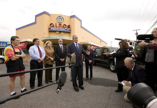 President George W. Bush and Mrs. Laura Bush are joined by local small business leaders for remarks on the economy Monday, Oct. 6, 2008, outside Olmos Pharmacy in San Antonio, Texas. White House photo by Eric Draper