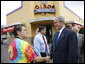 President George W. Bush shakes hands with Betty Garza, owner of Olmos Pharmacy, during his visit to establishment Monday, Oct. 6, 2008, in San Antonio, Texas. The Pharmacy -- no longer a pharmacy -- is known for its hamburgers and milkshakes and prior to becoming its owner, Ms. Garza served as its counter waitress for more than 35 years. White House photo by Eric Draper