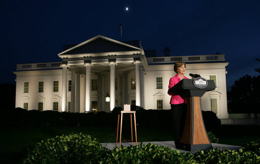 Mrs. Laura Bush prepares to push the button, Oct. 7, 2008, to light up the White House in a pink glow as part of Breast Cancer Awareness. Preventing and curing breast cancer is a cause that Mrs. Bush has worked toward around the world. White House photo by Chris Greenberg