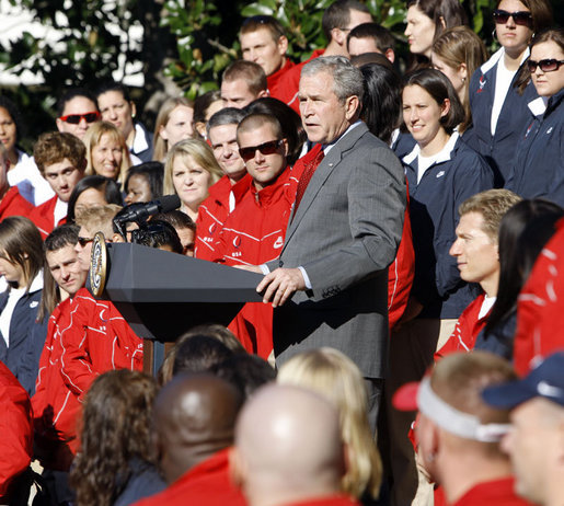 "President George W. Bush delivers remarks to the members of the 2008 United States Summer Olympic and Paralympic Teams Tuesday, Oct. 7, 2008, on the South Lawn of the White House. President Bush said, ""You amazed the world with your talent and grace and sportsmanship. You inspired children to chase their dreams. You will be champions forever."" White House photo by Eric Draper"
