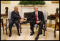 President George W. Bush welcomes Prime Minister Tillman Thomas of Grenada to the Oval Office Wednesday, Oct. 8, 2008, at the White House. White House photo by Eric Draper