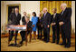 President George W. Bush signs H.R. 7081, The United States-India Nuclear Cooperation Approval and Nonproliferation Enhancement Act, Wednesday, Oct. 8, 2008, in the East Room at the White House. President Bush is joined on stage by, from left, Rep. Joseph Crowley, D-N.Y., Rep. Eliot Engel, D-N.Y., Secretary of State Condoleezza Rice, Sen. Chris Dodd, D-Conn., Senator John Warner of Virginia, Energy Secretary Samuel Bodman, India's Ambassador to the United States Ronen Sen and Vice President Dick Cheney. White House photo by Eric Draper