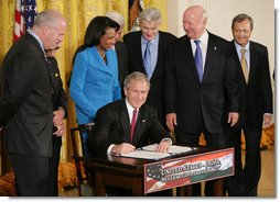 President George W. Bush signs H.R. 7081, The United States-India Nuclear Cooperation Approval and Nonproliferation Enhancement Act, Wednesday, Oct. 8, 2008, in the East Room at the White House. President Bush is joined on stage by, from left, Rep. Joseph Crowley, D-N.Y., Rep. Eliot Engel, D-N.Y., Secretary of State Condoleezza Rice, Sen. Chris Dodd, D-Conn., Senator John Warner of Virginia, Energy Secretary Samuel Bodman, and India's Ambassador to the United States Ronen Sen. White House photo by Eric Draper