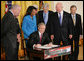 President George W. Bush signs H.R. 7081, The United States-India Nuclear Cooperation Approval and Nonproliferation Enhancement Act, Wednesday, Oct. 8, 2008, in the East Room at the White House. President Bush is joined on stage by, from left, Rep. Joseph Crowley, D-N.Y., Rep. Eliot Engel, D-N.Y., Secretary of State Condoleezza Rice, Sen. Chris Dodd, D-Conn., Senator John Warner of Virginia, Energy Secretary Samuel Bodman, and India's Ambassador to the United States Ronen Sen. White House photo by Chris Greenberg