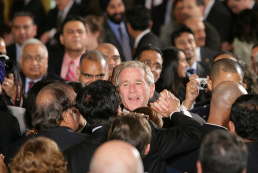 President George W. Bush reaches into the audience to shake hands after signing H.R. 7081, The United States-India Nuclear Cooperation Approval and Nonproliferation Enhancement Act, Wednesday, Oct. 8, 2008, in the East Room at the White House. White House photo by Chris Greenberg