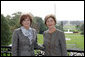 Mrs. Laura Bush greets First Lady of the Slovak Republic, Mrs. Silvia Gasparovicova, on the Truman Balcony of the White House, during Mrs. Gasparovicova's visit on Oct. 9, 2008. White House photo by Joyce N. Boghosian