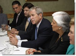President George W. Bush speaks with reporters at the conclusion of his meeting with Cuban American community leaders Friday, Oct. 10, 2008, at Havana Harry's restaurant in Coral Gables, Fla. President Bush is flanked by Javier de Cespedes, president of Directorio Democratico and Sylvia Iriondo, right, president of Mothers and Women Against Repression (M.A.R.) Por Cuba. White House photo by Eric Draper