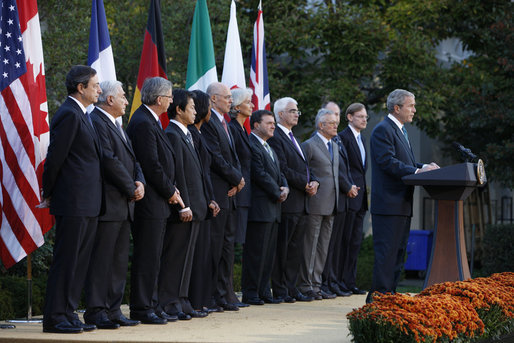 President George W. Bush delivers remarks after meeting with G7 finance ministers and heads of international finance institutions, Saturday morning, Oct. 11, 2008, in the Rose Garden at the White House. Pictured with President Bush from left to right are, Chairman of the Financial Stability Forum Mario Draghi, IMF Managing Director Dominique Strauss-Kahn, Eurogroup Chairman and Prime Minister of Luxembourg Jean-Claude Juncker, Japan's Finance Minister Soichi Nakagawa, Secretary of State Condoleezza Rice, Treasury Secretary Henry Paulson, France's Finance Minister Christine LeGarde, Canada's Finance Minister Jim Flaherty, Britain's Chancellor of the Exchequer Alister Darling, Italy's Economy Minister Giulio Tremonti, Germany's Finance Minister Peer Steinbruck and World Bank President Robert Zoellick. White House photo by Eric Draper