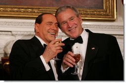President George W. Bush and Italian Prime Minister Silvio Berlusconi raise their glasses in a toast Monday evening, Oct. 13, 2008, during a State Dinner in honor of Prime Minister Berlusconi's visit to the White House. White House photo by Joyce N. Boghosian