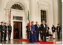 President George W. Bush and Mrs. Laura Bush welcome Italian Prime Minister Silvio Berlusconi Monday evening, Oct. 13, 2008, to the North Portico of the White House for a State Dinner in his honor. White House photo by Eric Draper