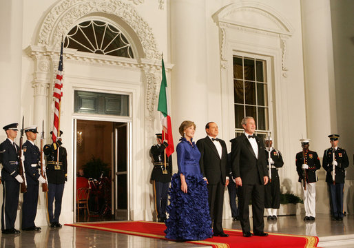 President George W. Bush and Mrs. Laura Bush welcome Italian Prime Minister Silvio Berlusconi Monday evening, Oct. 13, 2008, to the North Portico of the White House for a State Dinner in his honor. White House photo by Joyce N. Boghosian