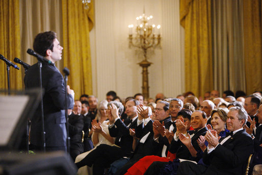 President George W. Bush and Mrs. Laura Bush are joined by Italian Prime Minister Silvio Berlusconi Monday evening, Oct. 13, 2008, as they listen to the Broadway cast of the Jersey Boys perform in the East Room of the White House. White House photo by Eric Draper