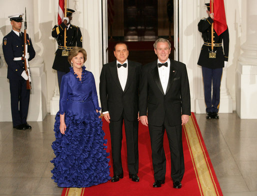 President George W. Bush and Mrs. Laura Bush welcome Italian Prime Minister Silvio Berlusconi Monday evening, Oct. 13, 2008, to the North Portico of the White House for a State Dinner in his honor. White House photo by Chris Greenberg