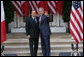 "President George W. Bush and Italian Prime Minister Silvio Berlusconi stand together following their remarks at a joint press availability Monday, Oct. 13, 2008, at the White House. President Bush said, ""I want to thank you for giving the American People the honor of celebrating Columbus Day with the leader of Italy."" White House photo by Chris Greenberg"