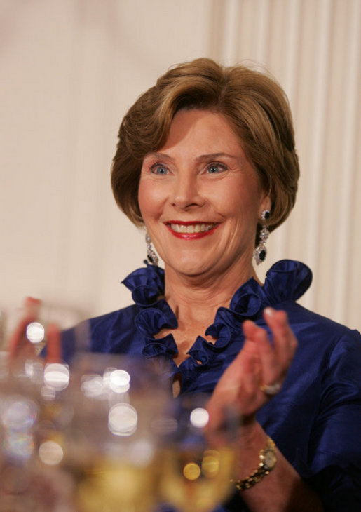 Mrs. Laura Bush applauds Italian Prime Minister Silvio Berlusconi as he his praised in an address by President George W. Bush Monday evening, Oct. 13, 2008, during the White House State Dinner in Berlusconi's honor. White House photo by Joyce N. Boghosian