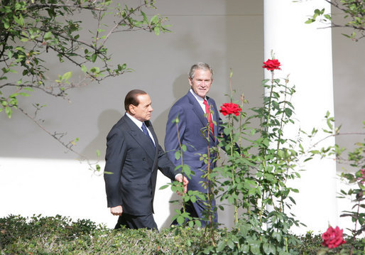President George W. Bush and Italian Prime Minister Silvio Berlusconi walk together Monday, Oct. 13, 2008 along the West Wing Colonnade, following their joint press availability in the White House Rose Garden. White House photo by Chris Greenberg