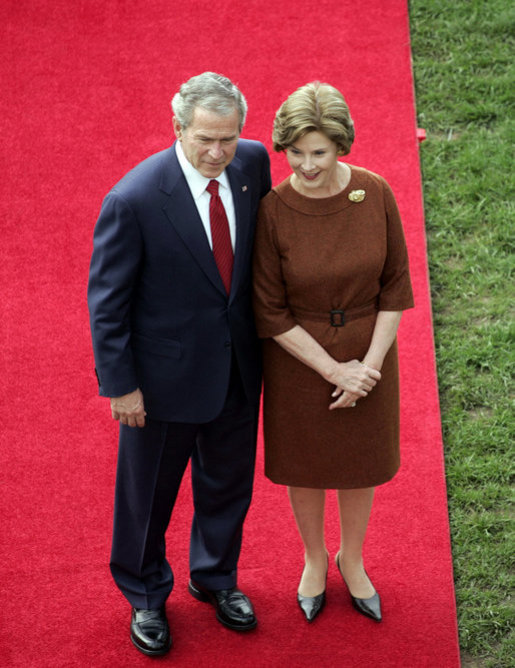 President George W. Bush and Mrs. Laura Bush stand together as they wait for the arrival of Prime Minister Silvio Berlusconi of Italy Monday, Oct. 13, 2008, during a South Lawn ceremony for the Prime Minister at the White House. White House photo by Grant Miller