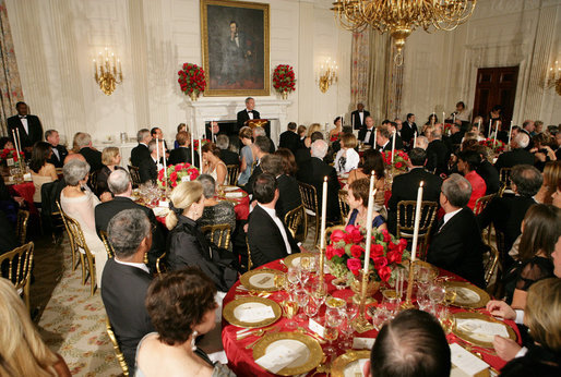 President George W. Bush addresses his remarks to invited guests Monday evening, Oct. 13, 2008, during the State Dinner in honor of Italian Prime Minister Silvio Berlusconi's visit to the White House. White House photo by Chris Greenberg