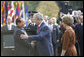 President George W. Bush and Mrs. Laura Bush welcome Italian Prime Minister Silvio Berlusconi upon his arrival Monday, Oct. 13, 2008 to the White House. White House photo by Eric Draper